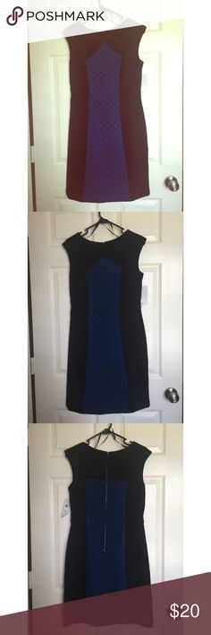 NWT black & blue shift dress with polka dot panel New with tags. Black shift dress with blue polka dot center panel. Black side panels have a slimming effect while polka dots add some fun to a structured outfit. Dresses Midi