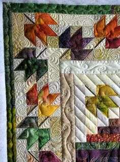 The Secret Life of Mrs. Meatloaf: A quilt for Autumn - love the quilting. Quilt pattern is Fall Foliage Spectacular by Judy Martin. Quilt Boarders, Quilt Blocks, 24 Blocks, Machine Quilting Designs, Quilting Projects, Quilting Ideas, Longarm Quilting, Free Motion Quilting, Halloween Quilts