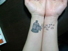 Birds and cage tattoo on wrist