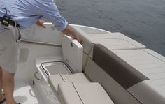 Bayliner 642 Overnighter: An idea place for trash or gear storage resides under the seat/step in the cockpit.
