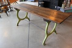 """""""mini"""" harvest table by rogue decor co.  reclaimed oak from an old workbench in the indianapolis gm stamping plant forms the top of this long and narrow table.  the legs are cast iron in original paint from an antique book binder. www.facebook.com/rogue.decor"""