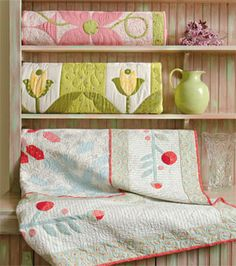Quilts displayed on a sideboard:  Home Sweet Quilt by Jill Finley