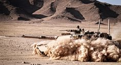 An M1A1 Abrams tank with Alpha Company, 1st Tank Battalion, Regimental Combat Team 6, patrols through the desert north of the Kajaki Dam in support of Operation Branding Iron.