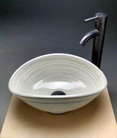 Oval Vessel Sink from Jeff Brown Pottery on Easy- if we get the sink custom made then we don't have to keep looking for the right measurements! And not expensive at around £350!