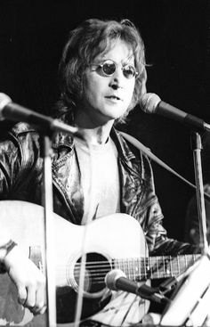 John Lennon performs onstage at the Chrysler Arena on December 10, 1971 in Ann Arbor, Michigan. Photo by Tom Copi/Michael Ochs Archives/Getty Images