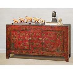 Hand-Painted Tibetan Cabinet.  Sporting a classy weathered look, this unique cabinet's doors display a gorgeous flower arrangement on a bold red background, painted by hand and aged to perfection. Tibetan furniture.