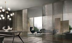 Velaria sliding doors in palladio aluminum and golden mesh glass.