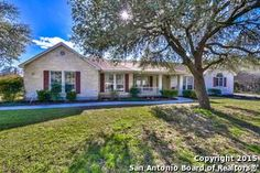 CONTACT US AT 210-219-0509... SAN ANTONIO REAL ESTATE!!  Beautiful custom home located nestled between two empty wooded lots with mature oak trees. Frequent deer sightings make some spectacular views on this private lot. This home features an open floor plan with spacious great room & large kitchen & granite counter tops. Great for entertaining! Updated flooring, fixtures, and a seamless glass shower in master bath. Circle driveway with lots of parking & side entry garage. Great master…