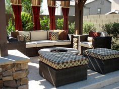 Backyard pergola. Stone fire-pit and pillars. Marbella pavers. Custom cushions and pillows made in Sunbrella fabrics: vellum, henna,  and tango mink. Furniture purchased at overstock.com.