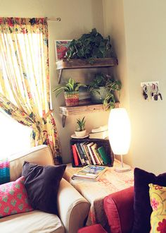 Cosy corner - Love the shelves and plants in not really assorted pots. Looks very natural and doesn't look like it has been styled for the picture. Love the arm rest height table in the corner to use up dead space and create cosy ness.