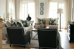 soft blue walls, white trim, neutral draperies and upholstery, pillows, light wood floor