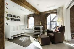 exposed brick baby room - gorgeous windows and wooden beams