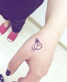 Small light bulb tattoo