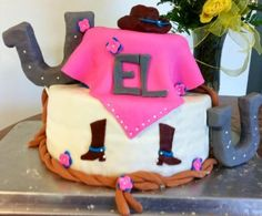 Cute little cowgirl baby shower cake