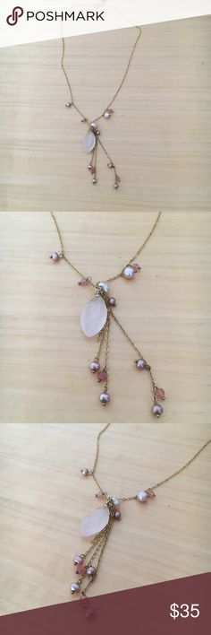 """Rose Quartz and Fresh Water Pearl Gold Necklace Necklace with unique mix of rose quartz pendant accented by an array of fresh water pearls and rose quart beads dangling on shorter lengths of gold chain. By Janna Connor. Length of chain is approx 16"""" with pendant and extra beading hanging another 2"""" lower. Perfect Mother's Day or graduation gift! Barely worn. In good condition. Janna Connor Jewelry Necklaces"""