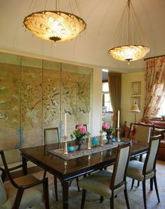 The Westchester house that Kitty Hawks and her husband Larry Lederman have spent 24 years perfecting: in the dining room silk Fortuny light fixtures hang above the mid-century table and chairs.