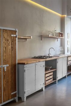 when you are reusing cabinets and need a spacer, why not consider an open shelf with a pull out box or basket, which can have a cover? or a chrome rack that pulls out for placing cast iron pans & pots, albeit upside down?
