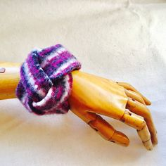 Felted wool braided bracelet from Repurposed sweaters in Pink White and Black Pattern Silver clasp closure  This Bracelet, as with all Reduxion items, is one of a kind and made from Repurposed and Upcycled products.