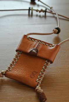 Inspiration pic only. I like how the pouch closes by pushing the top down the rawhide/leather strap.