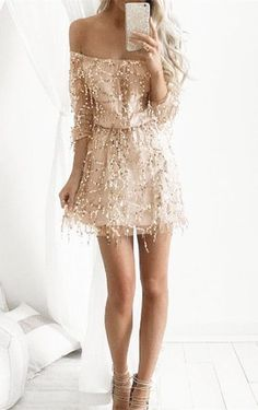 A sequin dress featuring an off-shoulder silhouette. Elasticized waist. Long sleeves. Finished hem. Lined.