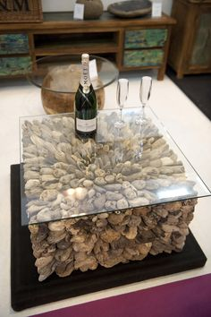 This outdoor glass table would be the prefect edition to a conservatory or patio. The design underneath the table includes stone to match the natural colours found outdoors. Backyard, Patio, Glass Table, Conservatory, Yard Ideas, Lounge, Gardens, Outdoors, Colours