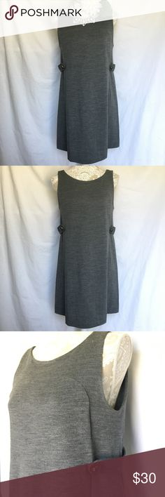 J. Crew // Grey Wool Jersey Stephanie Dress A lovely dress to be worn over a turtleneck in the winter, from J. Crew. Dark grey color. Shift style with button details on the waist. In good condition, small hole on the left hip shown in the last photo. J. Crew Dresses Mini