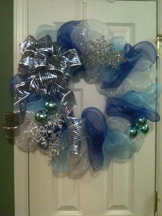 WINTER POLY DECO MESH WREATH.  THIS ONE IS ONE OF FOUR ON THE CHURCH DOORS.