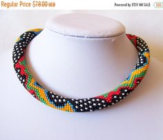 Bead crochet rope necklace is crocheted on 100% cotton thread with thousand of small Czech seed beads with geometric pattern . Very flexible and comfortable to wear. It is easy, elegant jewelry suitable for everyday use and special occasions. Is handmade especially for you. Length 18,5 inch (47cm). You can find matching Bracelet in my shop: https://www.etsy.com/listing/203963361/3-strand-colorful-multicolor-bead You can find matching Earrings in my shop: https://www.etsy.com/listing/2195...