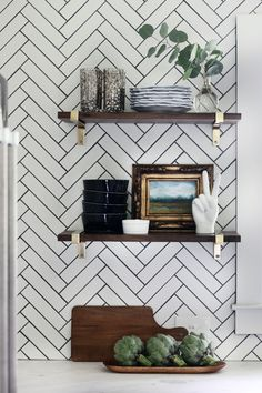 herringbone tile backsplash with black grout