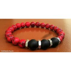 This is a combination of 8mm Red Howlite and 10mm Matte Black Onyx beads. Perfect for your style and personality. This Bracelet is made by order and so it can be customized to your exact wrist size. Item ships within 1-2 business days of receiving payment. Please contact me if you have any questions or requests for this Bracelet. For my other items visit Krestbeads.etsy.com Thank you for checking out my listing.