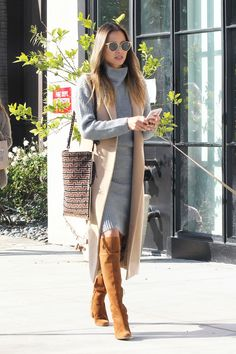 Lovely Layers: Jamie Chung's Grey Sweater Dress and Camel Vest . Read more The post Lovely Layers: Jamie Chung's Grey Sweater Dress and Camel Vest Look for Less appeared first on How To Be Trendy. Cognac Boots Outfit, Long Boots Outfit, Winter Boots Outfits, Winter Outfits Women, Casual Winter Outfits, Dress With Boots, Camel Boots, Brown Boots Outfit Winter, Winter Dresses With Boots