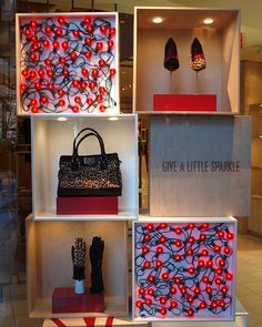 stack wrapped boxes and display product inside....COLE HAAN Holiday Window Display! #visual_merchandising #retail