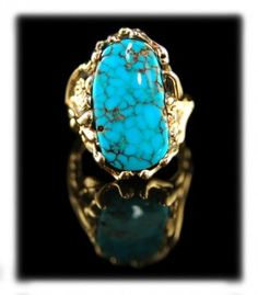 Women's gold and spider web Bisbee Turquoise ring by John Hartman. A extremely rare, natural, spider web / water web Bisbee Turquoise cabochon is the star of this unique gold ring for women / Ring was modeled after vines with flowers on them / American Turquoise cabochon from the Bisbee Turquoise mine in Bisbee, Arizona USA. Each side of this ring features a different design and features a handmade gold daisy flower. Hand made in Durango, Colorado USA are stamped 14k /3995.