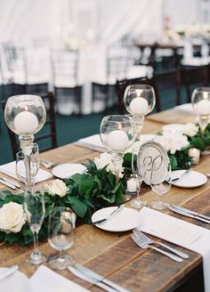 Guests then entered a clear tent where they were able to dine under the stars at long banquet tables lined with lush green table runners accented with white blooms.