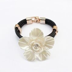 This bracelet is really special. The flower has been treated with a specialized pearl finish. At it's heart, there is a Czech crystal. The band is made from