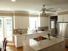 If soffet in canbibet and refacing add molding to both top of canbinets and top of the wall over soffet touching ceiling just like this picture white shaker cabinets a plus Remodel Kitchen - Phillips - contemporary - kitchen - charlotte - by Case Remodeling