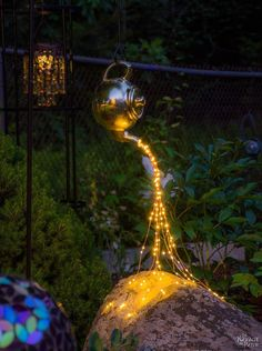 Enchanting DIY addition to any garden, but especially a GYPSY garden!  Spilling Solar Lights {Teapot Lights} | Easy, budget friendly and one of a kind DIY backyard ornament and landscape lights | Upcycled teapot | Step-by-step tutorial for DIY spilling solar lights {Teapot solar lights} | DIY whimsical garden lights | Before & After | TheNavagePatch.com