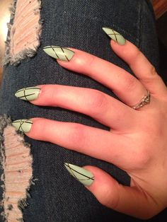 Mint green/ mint blue/ sky blue matte stiletto nails with thin black, silver, and gold metallic diagonal cross stripes For New Year's Eve
