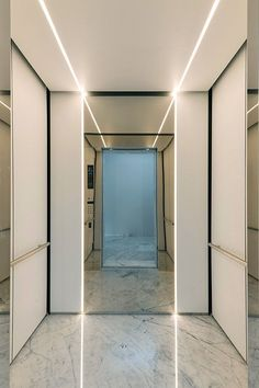 LEVELe-105 Elevator Interior with customized panel layout; Minimal panels in Bonded Quartz, White with custom pattern, Stainless Steel with Mirror finish; Round handrail; custom ceiling in Bonded Quartz, White at Yoo Pune, Pune, Maharashtra, India ~ Great pin! For Oahu architectural design visit http://ownerbuiltdesign.com