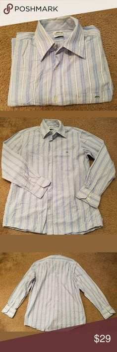 Lacoste Mens Devanlay Blue Striped Long Sleeve This is a really great pre-owned Lacoste Mens Devanlay Blue Striped Long Sleeve Button Down Shirt Size 40/M. It is in pre-owned condition. It is blue and white striped. There are no holes, stains, rips, tears or pulls anywhere in the fabric. All buttons are attached. All measurements are pictured. Please review all pictures carefully for condition and measurements.?  Armpit to armpit: 23.5 inches? Length: 30 inches? Sleeve: 19.5 inches? Lacoste…