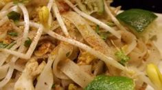 Inspired by the pad thai at Thai Tom, this recipe features a tamarind paste, vinegar, sugar, and fish sauce mixture over perfectly stir-fried eggs, chicken breast, and rice noodles, garnished with peanuts, chives, and fresh bean sprouts.
