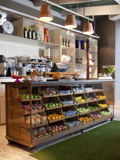 Love the whole idea of astroturf as shop flooring also who'd have thought these vintage counters would look so good with fruit and veg in! great display, lighting - brilliant