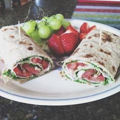 Turkey, hummus, spinach & tomato wrap with grapes and strawberries
