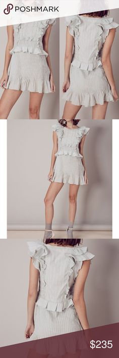 NWT For Love and Lemons Mini Dress Tiered Ruffle New with tag For love and lemons  Pleated details, ruffle accents, and a feminine vibe define The Starry Eyed Dress. With a fitted silhouette to show off some curves and the length leading way for your legs,  it is easy to see why this dress brings out the sparkle in your eyes. Cotton blend Dry clean only Unlined Lace and tiered ruffle trim Pleated detail Hidden side zipper closure Inset ruffles Tiny trim detailing Lurex twill panels…