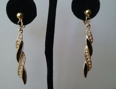 Crown Trifari Dangle Clip Earrings ~Gorgeous long Crown Trifari dangles with a twist! The shiny black enamel alternates with strips of rhinestone encrusted shiny gold giving these elegant clip on dangles a modern twist. They are signed Trifari with the crown above the T. A gift box is included with your purchase today.~Vintage $34.99