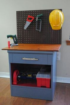 could do the same idea but will a small older dress for a little boys room tool bench