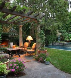 Tropical Mediterranean Backyard Garden Landscape - A Mediterranean garden design. Tropical Mediterranean Backyard Garden Landscape - A Mediterranean garden design is characterized by stone structures an. Design Patio, Backyard Patio Designs, Backyard Ideas, Backyard Seating, Sloped Backyard, Patio Ideas, Backyard Retreat, Nice Backyard, Tropical Backyard