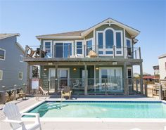 WILD HORSES, #263 l Duck, NC - Outer Banks Vacation Rental Home l Oceanfront home with six master suites, game/media room with pool table, home theater, sunroom, loft office with work station, private pool with option to heat, dune-top hot tub and private beach walkway with dune-top deck. l www.CarolinaDesigns.com