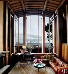 With stunning 27-foot-tall windows offering a dramatic view of San Francisco, it's nearly impossible to notice anything else in the living room of Ken Fulk's 1950s home by Bay Area modernist Warren Callister, featured in April 2014. On closer inspection, a collection of beautiful pieces comes into focus, including a vintage de Sede sectional sofa and a circa 1910 Steinway piano.