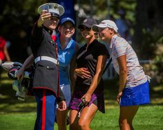 Marine Corps Sergeant Justin Tellar takes a selfie with professional golfers Katherine Perry, Alexandria Jacobsen and Kaitlin Coons following their completion of the W. B. Mason Championship at the Thorney Lea Golf Club.